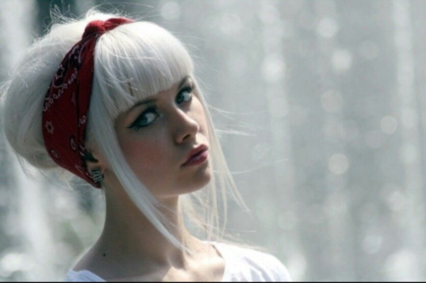White hair with blunt bangs.