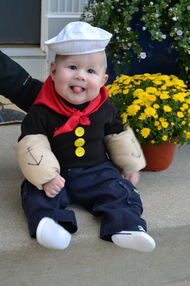 Halloween Idea. All homemade costume. The sailor hat is from Build-a-Bear, I sewed the yellow buttons to a long-sleeve black shirt. I have zero sewing experience, but stuffed skin colored fabric full of cotton balls (cheap method) and sewed together with Velcro to wrap around his arms.