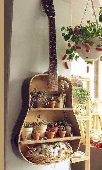 We love to see items turned into garden planters. This is so creative. Guitar ...