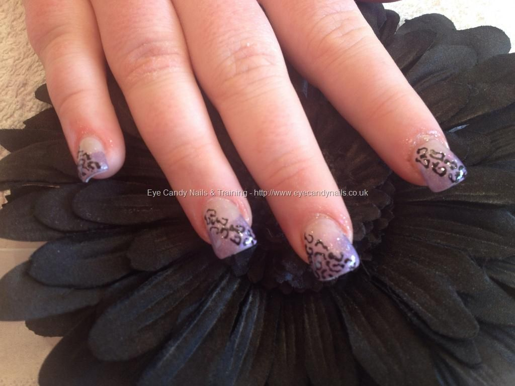 Full set of acrylic with purple polish and leopard print