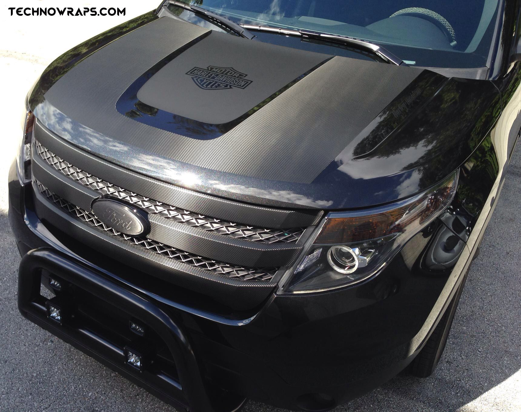 3m series 1080 black carbon fiber and matte hood wrap on ford explorer installed by
