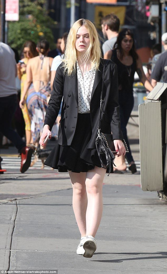 485ac9fadf Preppy: The blonde beauty, 19, was clad in a preppy ensemble for her  outing, donning a knee-length pleated skirt