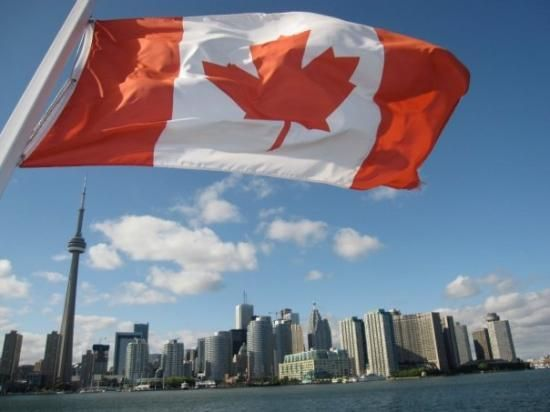 canada flag and toronto skyline