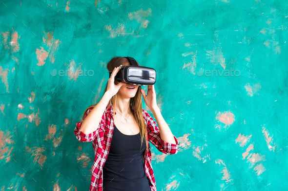 f51dfe347c3e girl getting experience using VR-headset glasses of virtual reality  gesticulating hands by Satura . happy smiling young beautiful girl l getting  experience ...