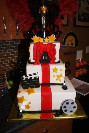 Everything made from fondant on this Hollywood cake, except the topper, feathers, and the black decorations sticking out of the side. The directors board was printed on the edible paper!!    Edible Inks, Eatable Ink, Printer Edible Ink, Bulk Edible Inks, Ink food