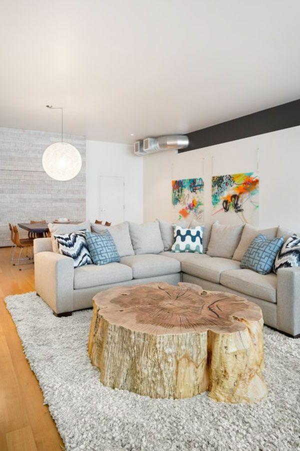 weißes wohnzimmer mit einem großen ecksofa und einem extravaganten ... - Massivholzmobel Ideen Esstisch Baumstamm