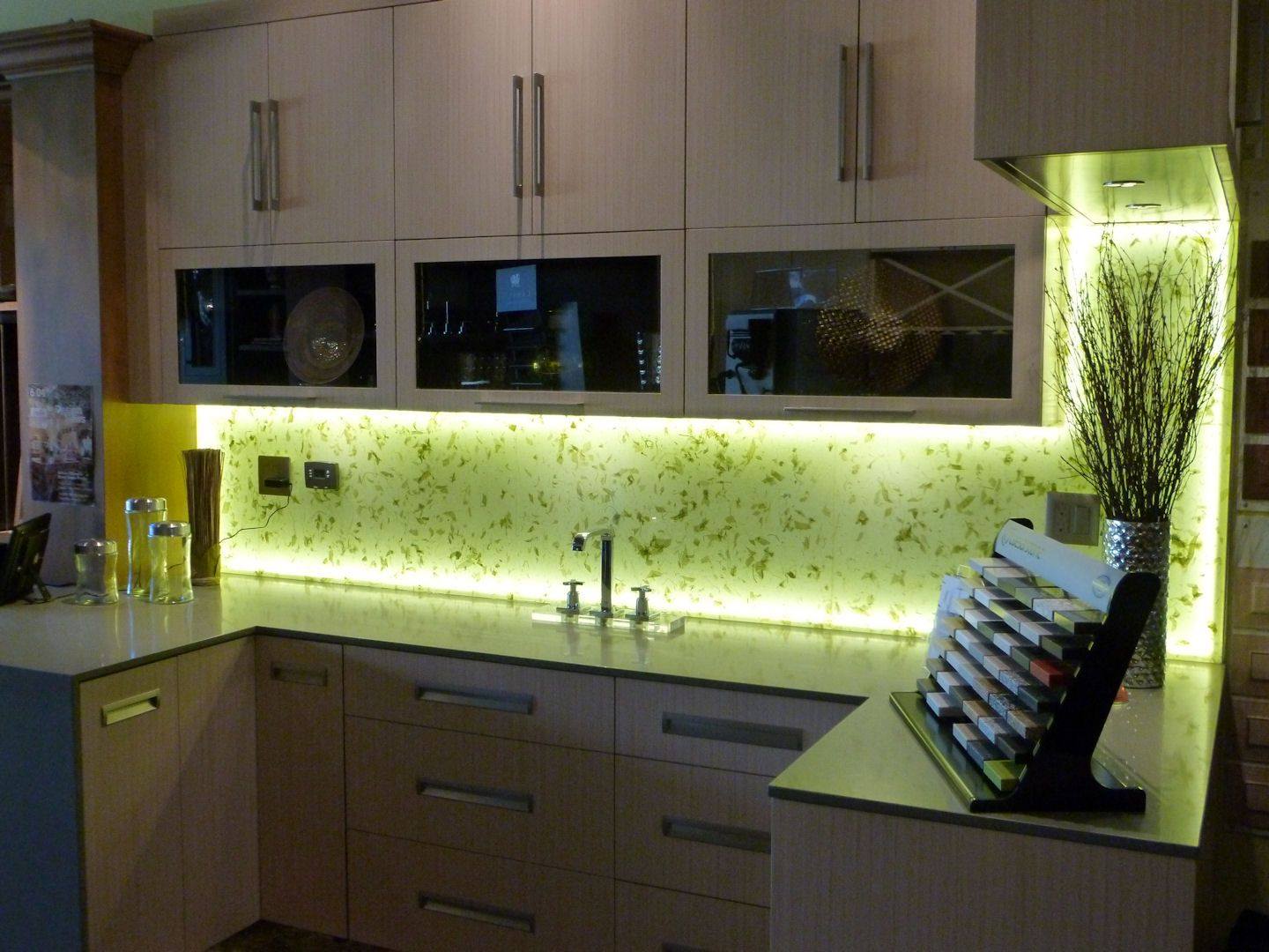 Rice paper is laminated between two glass panels and back lit with led lighting for this kitchen backsplash