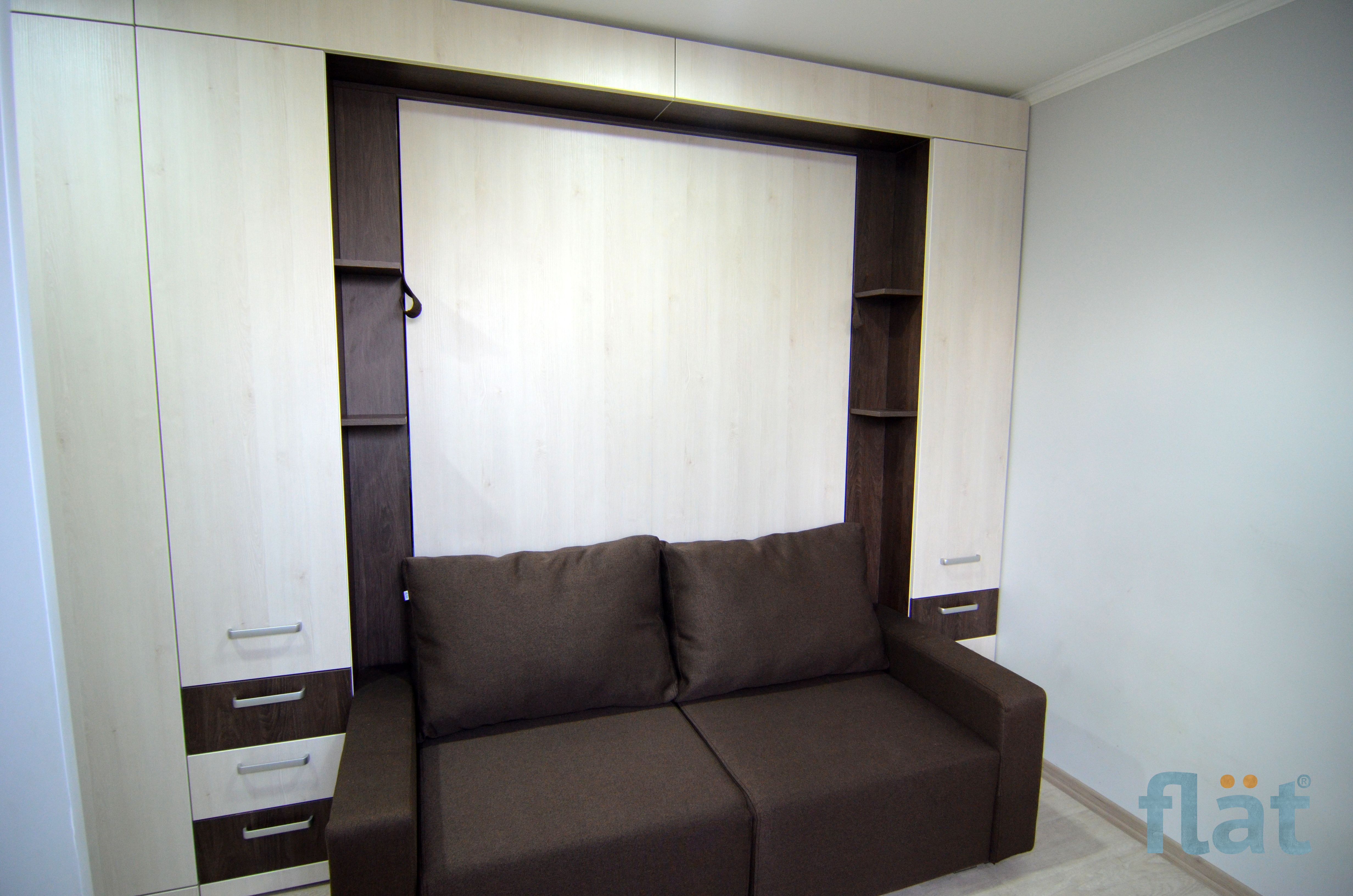 Very small space. Double size wall bed with sofa and