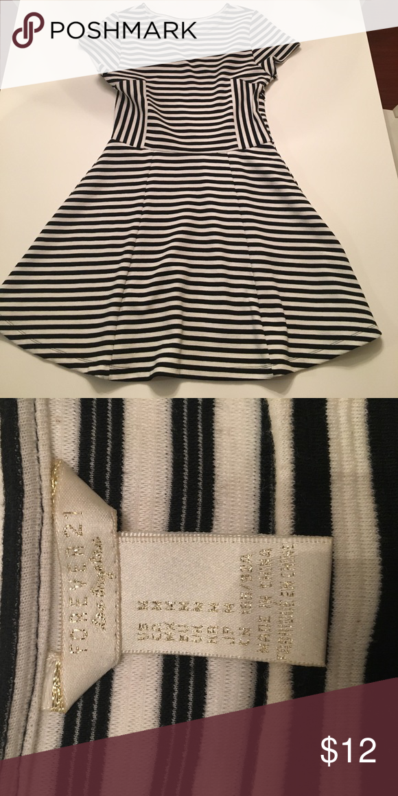 Forever 21 Striped Dress Forever 21 black and white striped dress in size M.  Material is very soft and stretchy but does have side zipper.  Material is nice heavy weight.  Dress is a mini skirt length, very cute! Worn once and comes from a smoke free, pet free home 💜 Forever 21 Dresses Mini