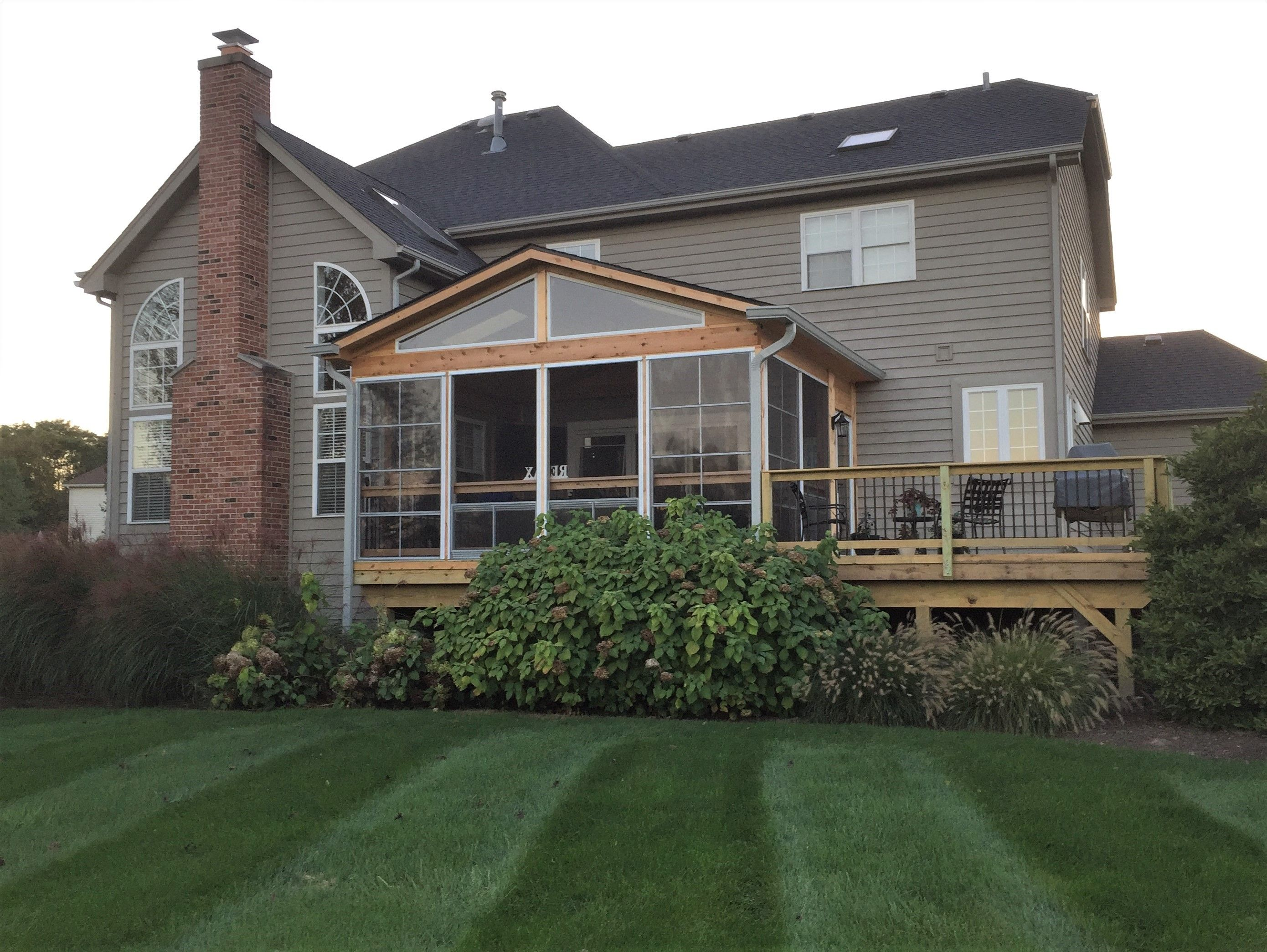 this screened porch and deck combination was custom designed and