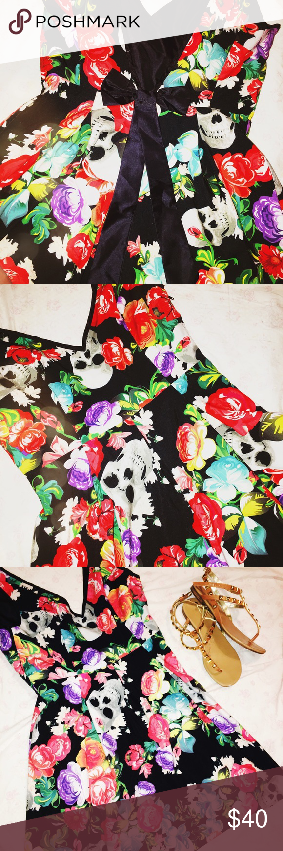 Bow back skulls and flowers dress Size S Bow deep V open back skulls and flowers dress Size S Brand tag is like 9 7 with a heart. So edgy. Rockabilly pinup style. Too fun! Dresses