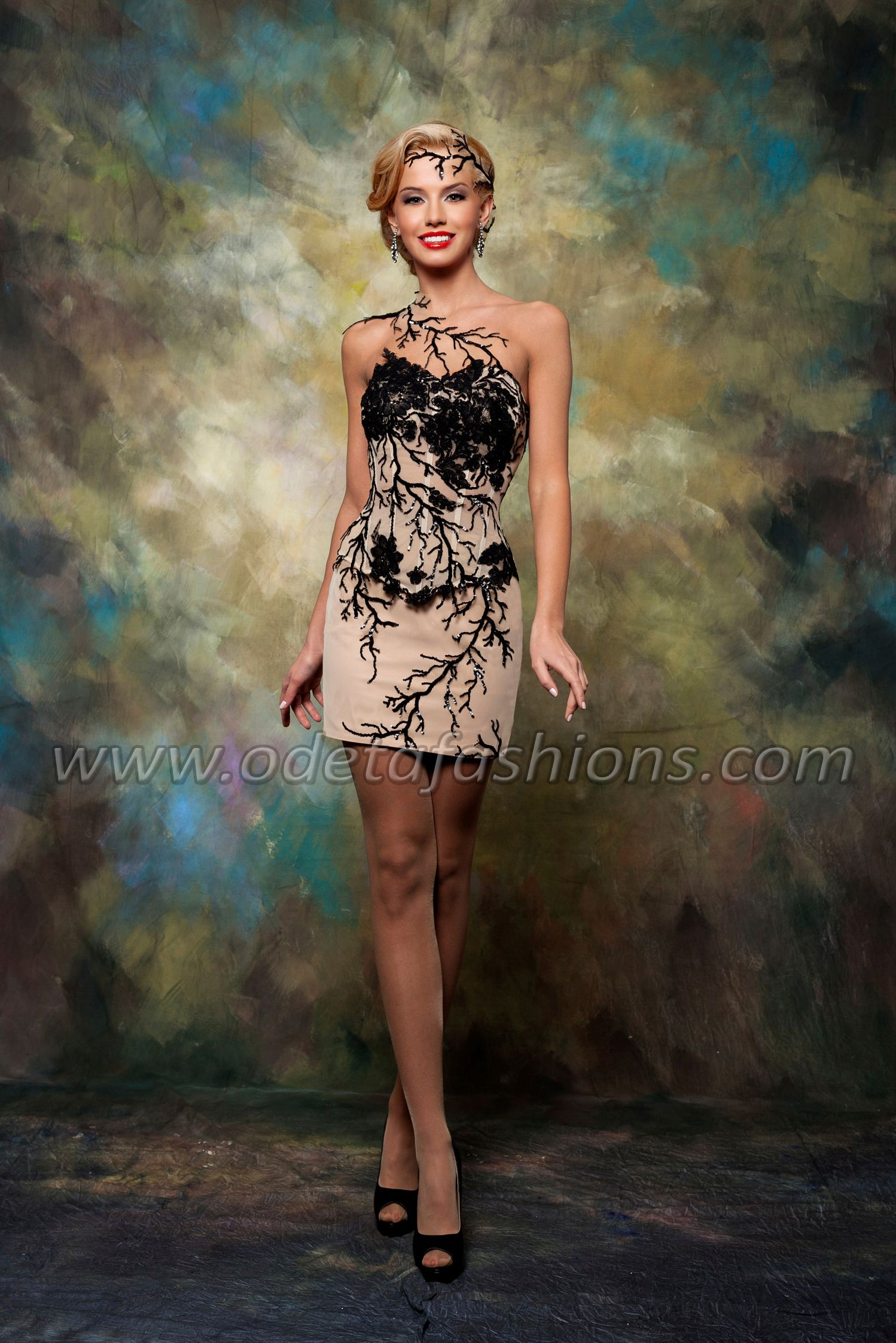 A short dress with hand made lace decoration.