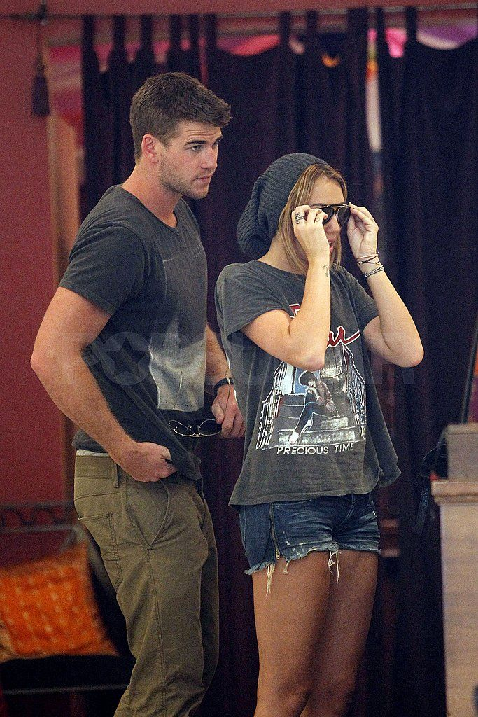 ~Miley Cyrus and Liam Hemsworth wore matching sunglasses. (Aug. 2011) Image Source: Pacific Coast News Online~