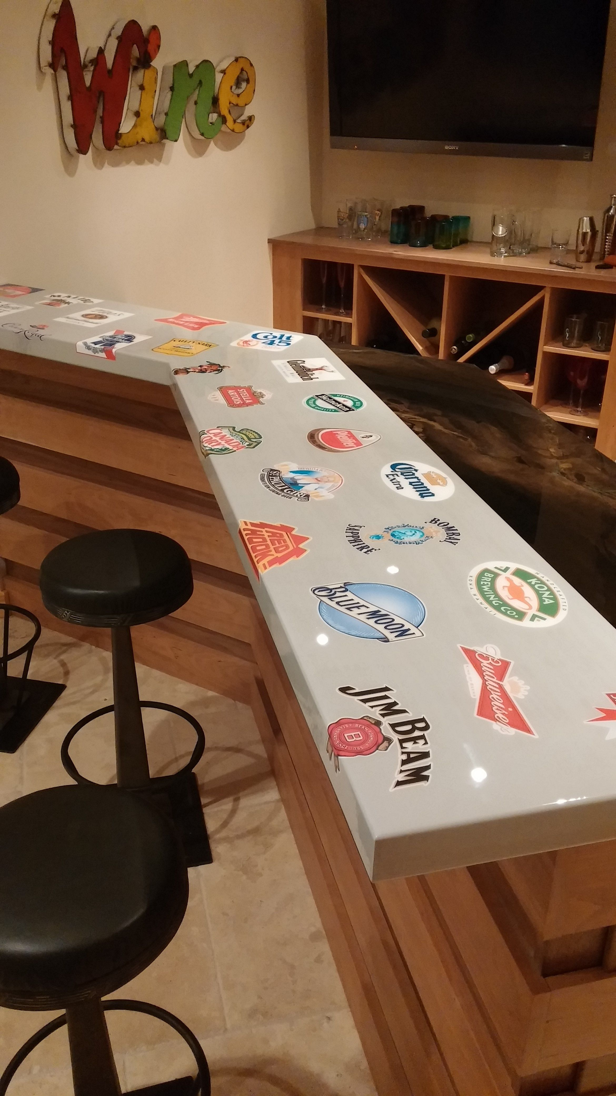 Custom Bar With Beer Logos And Black And Gold Epoxy