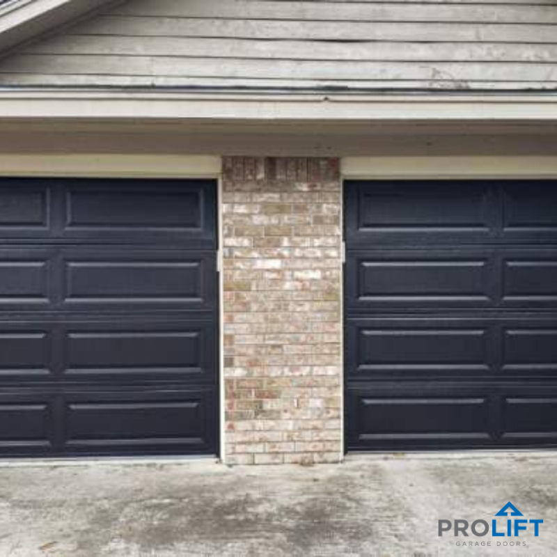 Long Panel Steel Garage Doors Without Windows In A Trending Dark Color In 2020 Garage Door Windows Garage Doors Steel Garage Doors