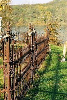 rusty iron fence around Vernon cemetary