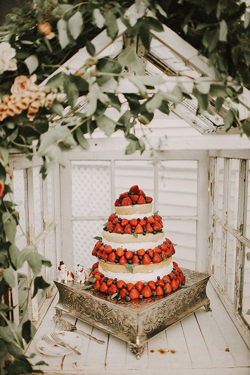Vintage-Chic Farm Wedding in Michigan, Naked Vanilla Cake Decorated with Fresh Berries | Brides.com