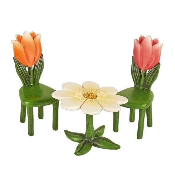 Fairy Garden  Mini  Tulip Table and Chairs  Miniature Supplies Accessories Dollhouse is part of Mini garden Table - Do you need to have some fun and interesting places where your fairies can sit and chat or have a meal  Whether you place this outside of a fairy house, a little café, or just about anywhere else, it is going to impress those who see it  The Tulip Table and Chairs have a wonderful plant theme, and this makes it perfect for the fairies  One of the chairs has an orange tulip, and the other has a red tulip Dimensions Table 2 25  Wide x 2 25  Deep x 1 75  High  Chair 1 25  Wide x 1 5  Deep x 2 75  HighMaterial Resin