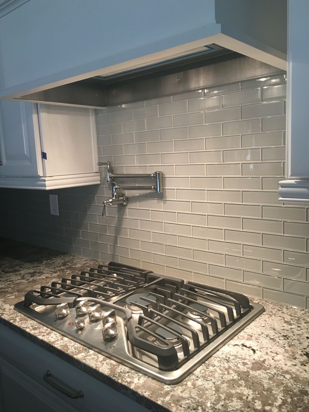 bianco antico granite mist glass tile backsplash white cabinets 5 burner ge profile