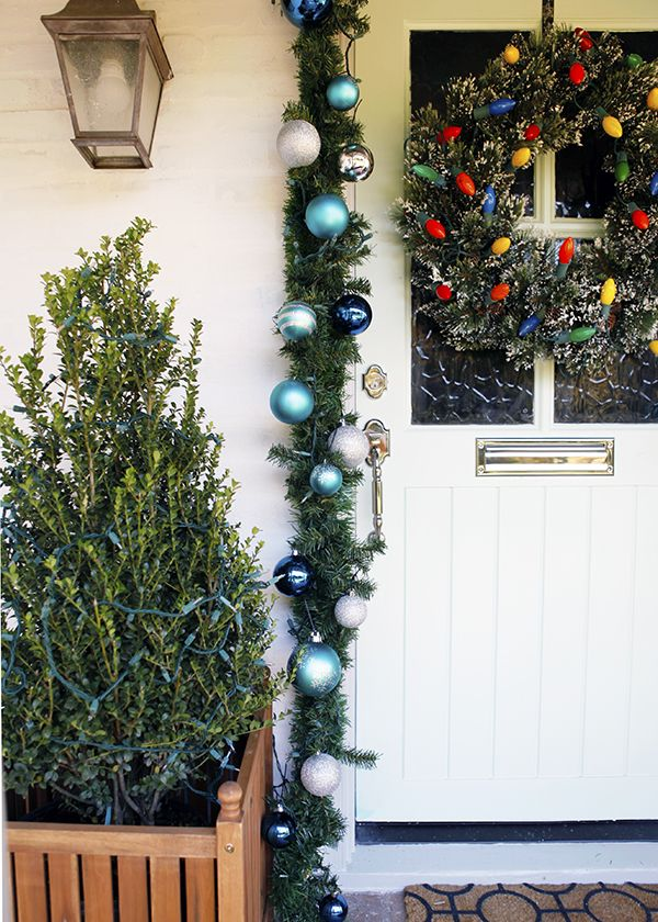 Use large japanese holly plants on either side of the door to add a