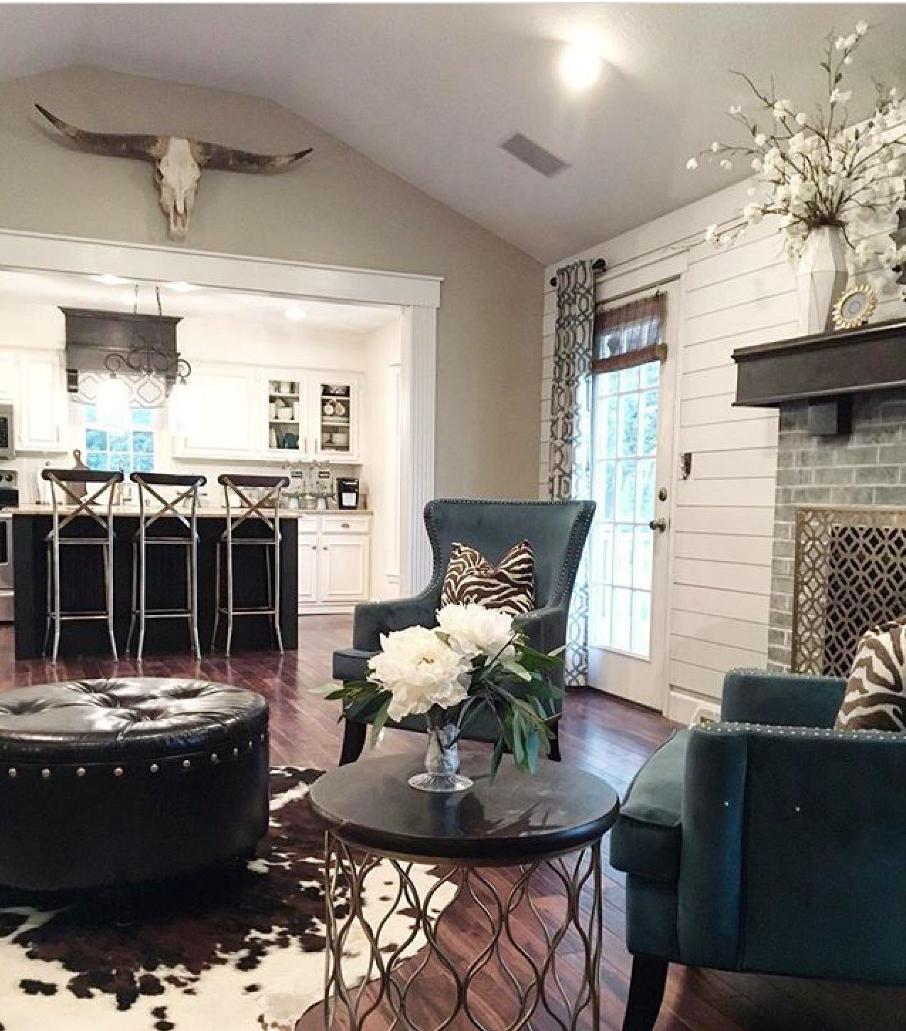 Farmhouse Great Room With Modern Design Elements Gold Accents Rustic Wood Mantle Shiplap C Farm House Living Room Cowhide Rug Living Room Cowhide Living Room