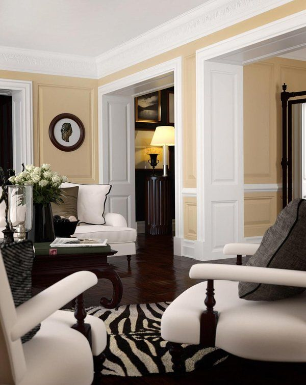 Chic Living Room. Warm Wall Color + White Trim + Dark Floors +