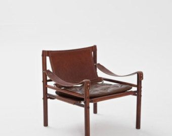 An Arne Norell safari chair in brown leather and rosewood