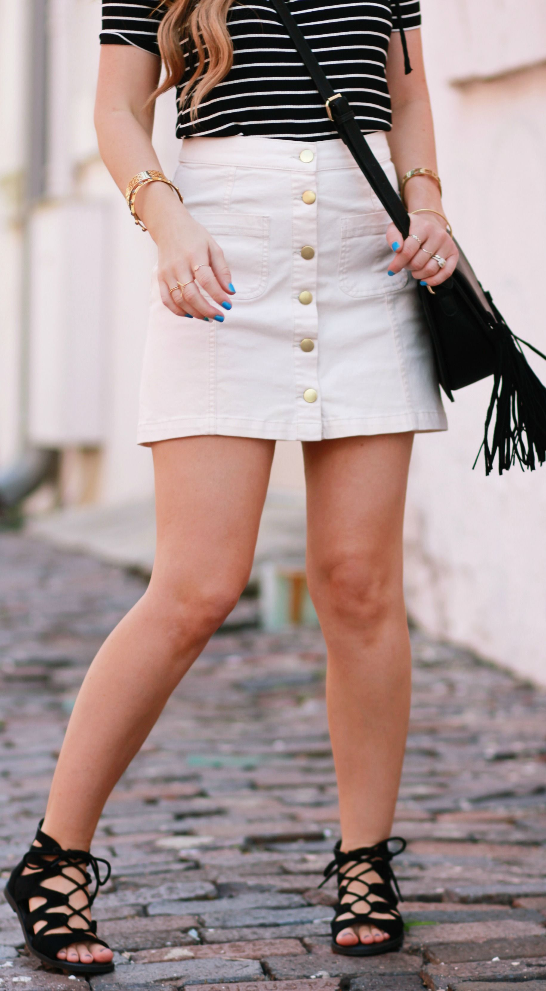 be351a4b875c Stripes and button up skirt styled with lace up gladiator sandals and fringe  bag for an