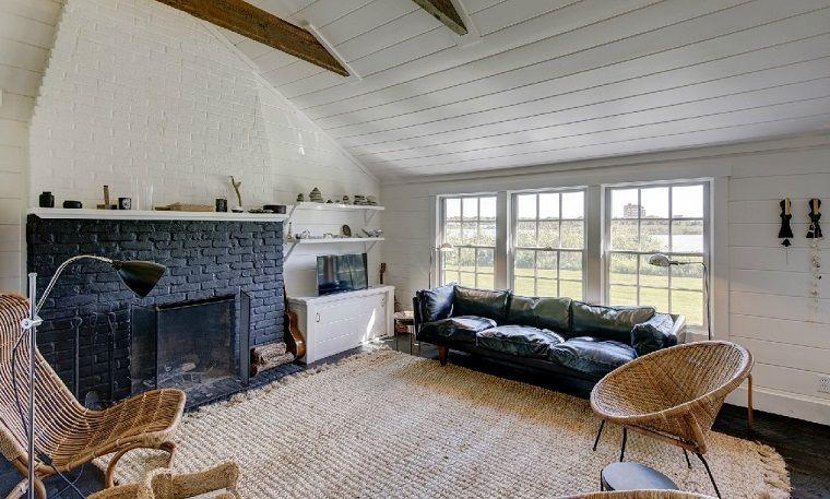 Soggiorno Camino ~ Camino rustico idea arredo soggiorno pietra tappeto soffitto