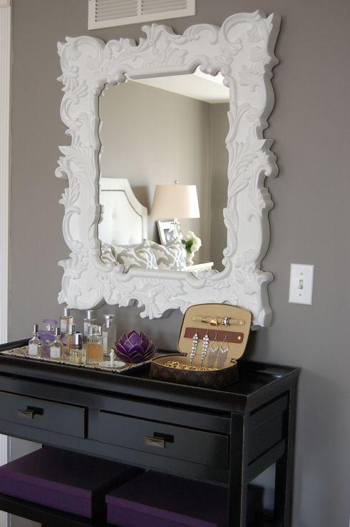 gray bedroom with baroque mirror