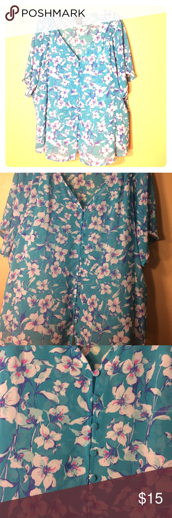 Torrid blouse This is my favorite print from Torrid! This shirt has 0 snags and the buttons are in perfect condition. This shear light weight top is a blue-teal with hot pink, purple and white flowers. It hangs loose for a 1x but is so beautiful! torrid Tops Blouses