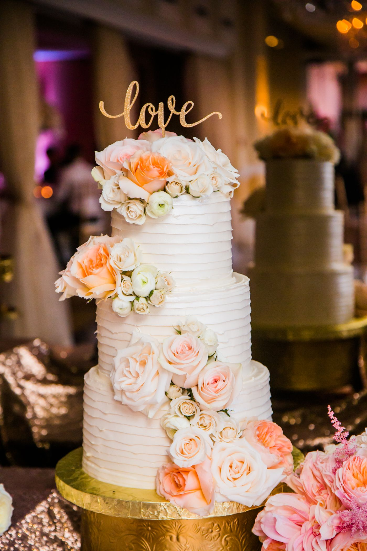 3 tier cake with blush flowers wedding cakes tiered