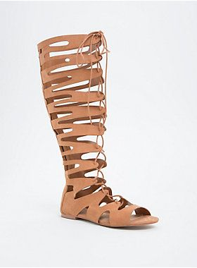 """Duke it out in style with these gladiator sandals. The knee-highs are chicer than any other warm-weather sandal with cutouts detailing the camel faux suede straps all over. The lace up front gets you noticed, with a zip back that keeps you secure.<div><ul><li style=""""list-style-position: inside !important; list-style-type: disc !important"""">TRUE WIDE WIDTH: Designed so you never have to size up again. For the perfect fit, we recommend going down a whole size.</li><li…"""