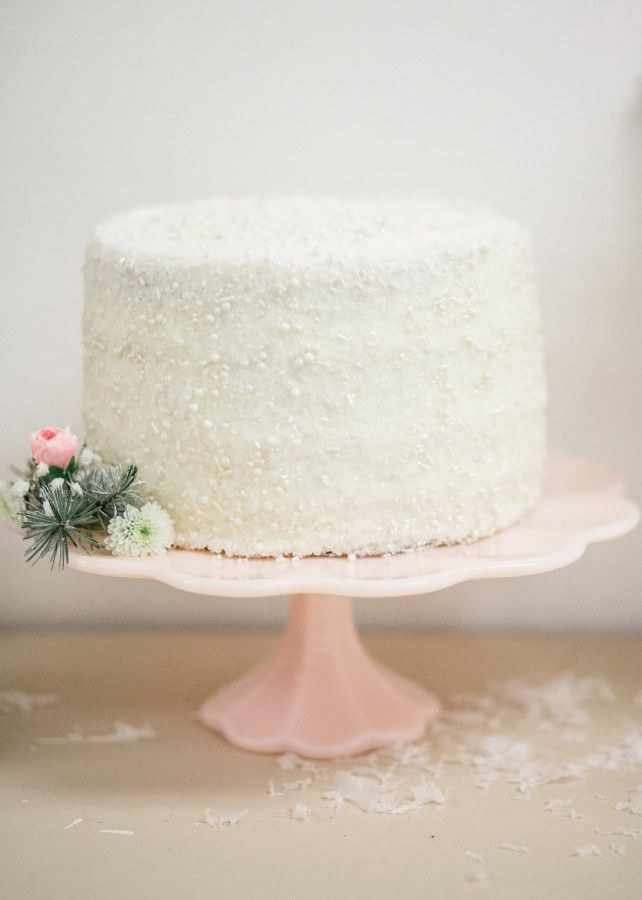 Beautiful white cake with sparkles for a winter wonderland themed birthday party Jennycookies.com