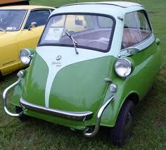 1958 BMW Isetta.  My Dad had a red one when I was a kid & it was pretty cool & fun. Just found out last year it was a BMW.