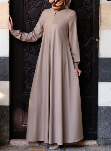 Easy Care Flared Abaya Almondine color asked for it, and we are happy to oblige: Finally, a wrinkle-resistant version of our popular abayas! The name says it all, and it's as easy to wear as it is to care for. Elasticized sleeves, a front opening, and the perfect flattering, feminine flair work together to create one beautiful, practical piece you'll be reaching for day after day.