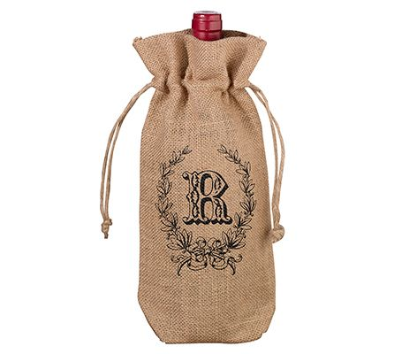 "Cover a wine bottle in style and accent the tables with this burlap wine bag. It can be purchased as is or personalized for that individual touch. Bag measures 6.25"" x 12""."