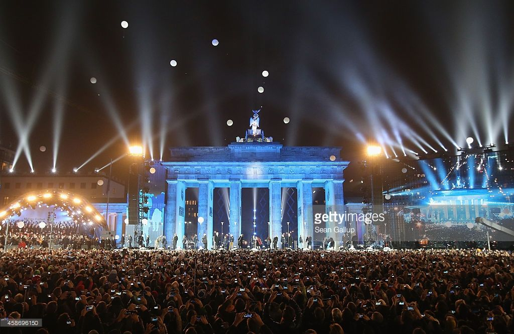 Symbolizes the collapse of the Berlin Wall in front of the Brandenburg Gate during celebrations on the 25th anniversary of the fall of the Berlin Wall on November 9, 2014 in Berlin, Germany.