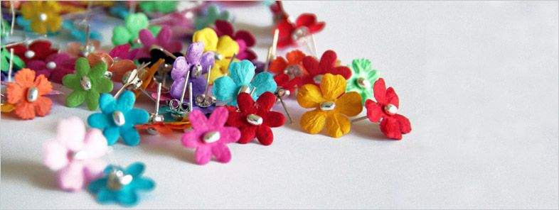 'bloom' scented flower earrings by designboom, based on an idea by jee toh peng sun. apply your own daily fragrance to these disposable paper flower earrings.