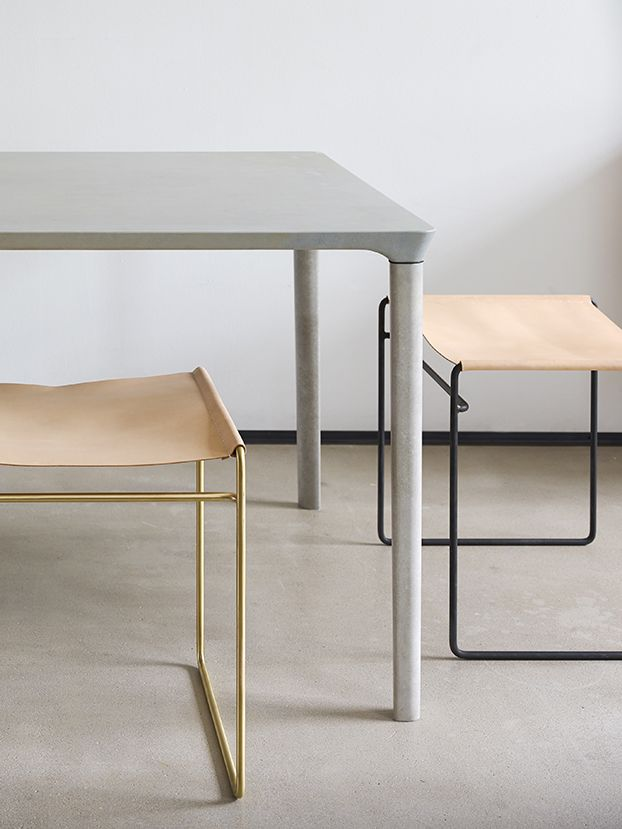 Pale leather wrapped brass raw steel stools by Nina Mair