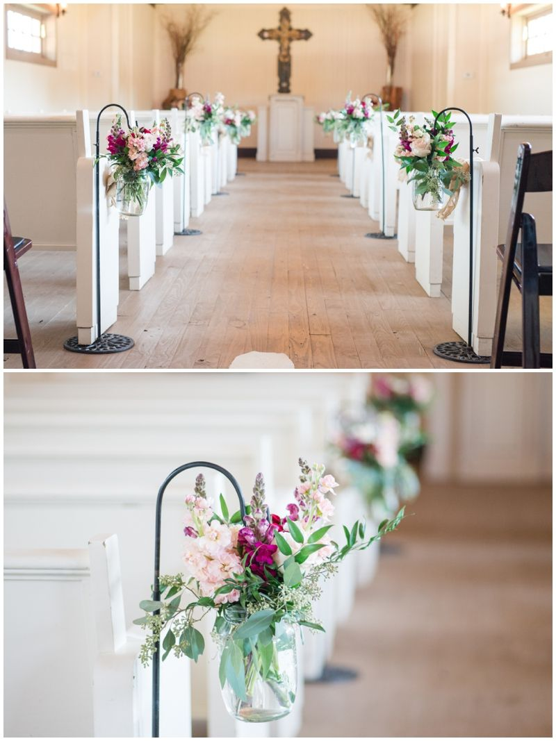 Burgundy And Blush Floral Aisle Markers Line The Inside Of Twisted