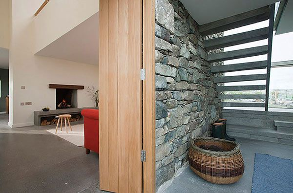 Two Stone Cottages Fused With A Glass Stairwell Enclosure - http://freshome.com/2012/05/31/two-stone-cottages-fused-with-a-glass-stairwell-enclosure/