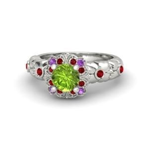 A beaming center gem rests atop a studded floral arrangement and a thin, gem-accented wreath. It's a dazzling member of our collection. $1480 by tonia