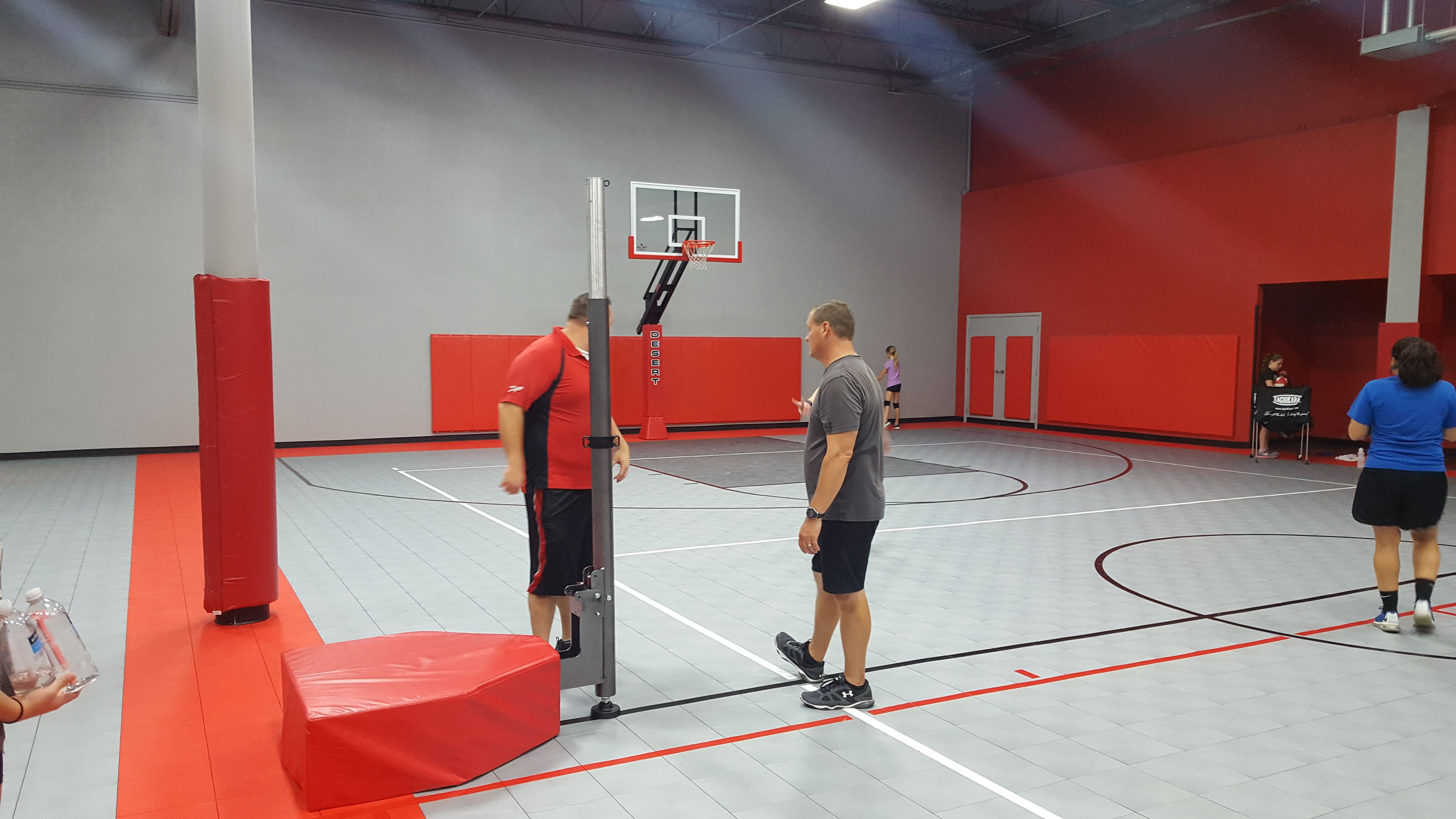 Here Is A Picture Of A Newly Completed Gymnasium In The Background Is A Titan Arena Adjustable Basketball Goal Basketball Room Volleyball Set Basketball Goals