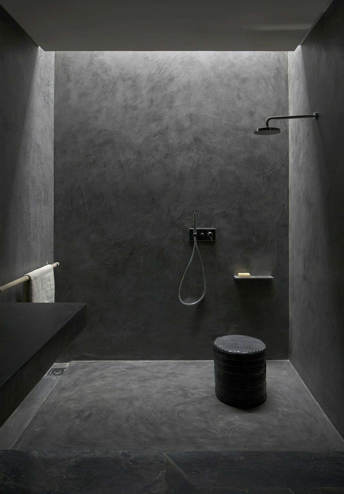 concrete is becoming a popular option in many interior bathrooms