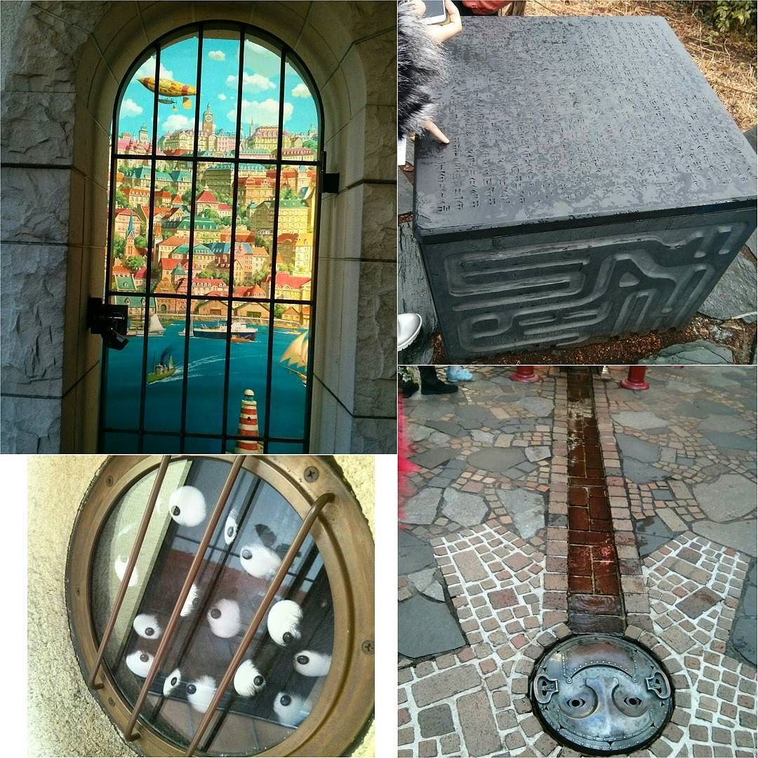 Some other cute outdoor shots of the Ghibli museum! A gated entrance painted with the town from Porco Rosso (I think!) a window stuffed full of soot sprites the cube from Laputa and a drain cover with a smiley man on it! The details of the museum were so cute and whimsical! #ghibli #totoro #otakuadventure #tokyo #japan #castleinthesky #porcorosso #museum by iamchubbybunny