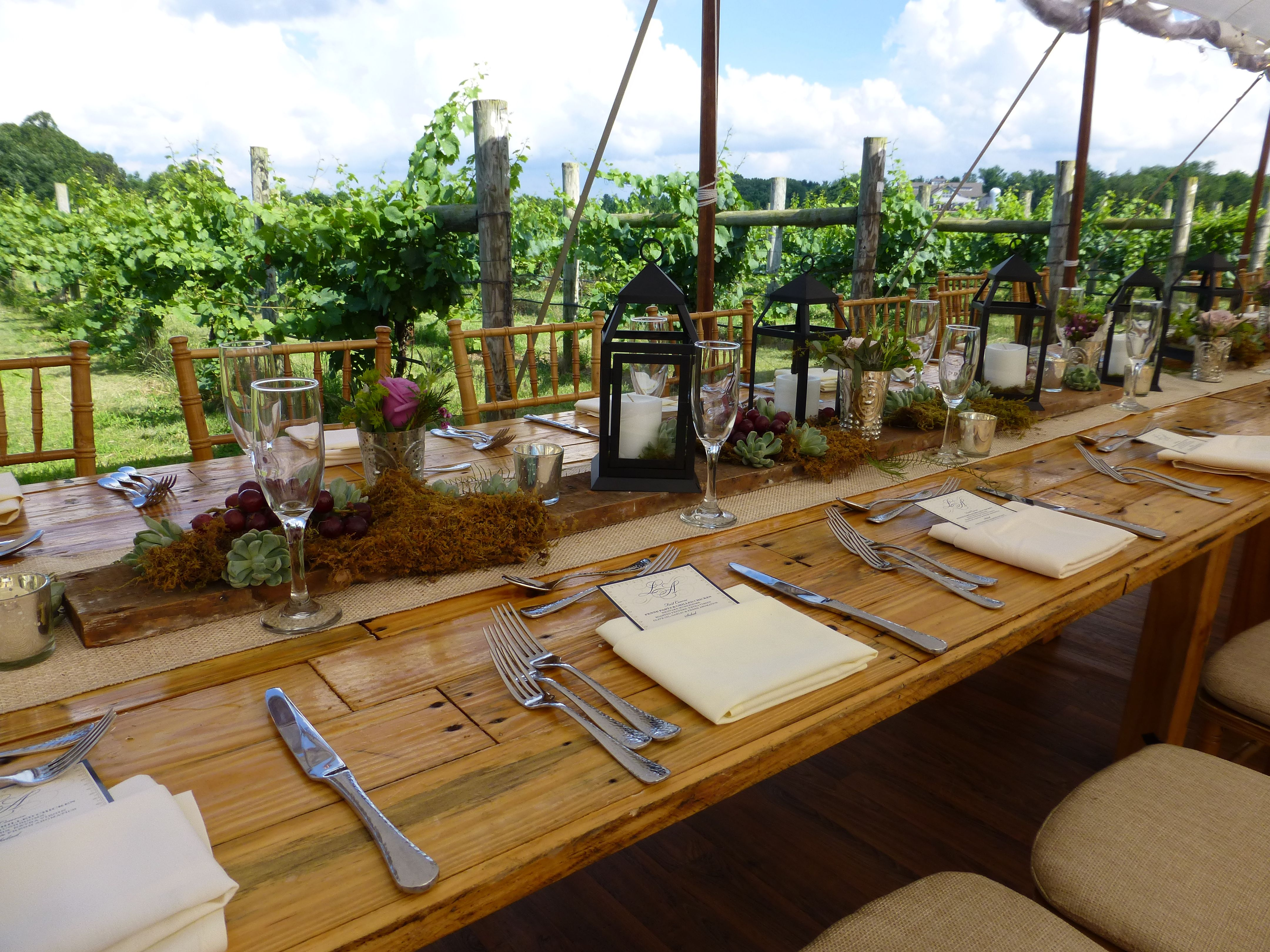 beautiful vineyard wedding at laurita winery in new jersey head table designed by petal beach