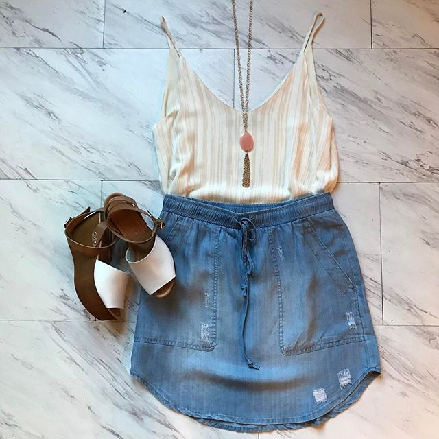 Freshen up your chambray collection with this skirt! It's perfect for a weekend day on the town or comfortable enough for a day of travel! #shopatl #atlantaboutique #shopsmall #shoplocal #stayHIP #handinpocket #summertrends #ootd #outfitinspiration #chambrayskirt #flatlay #marble #denimskirtoutfit #whitetank #daytimeoutfit