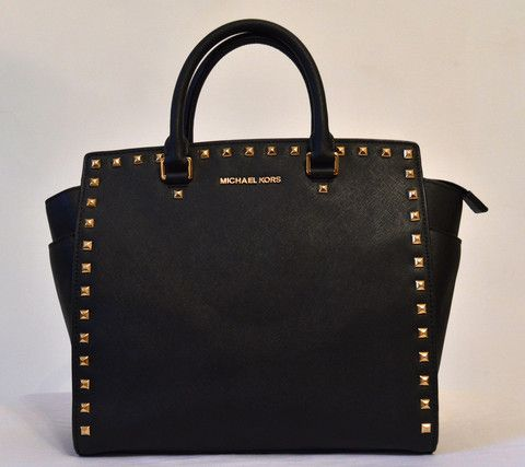 This classic #michaelkors Selma bag in black with gold studs is on sale at www.secretstash.pk - we deliver across Pakistan