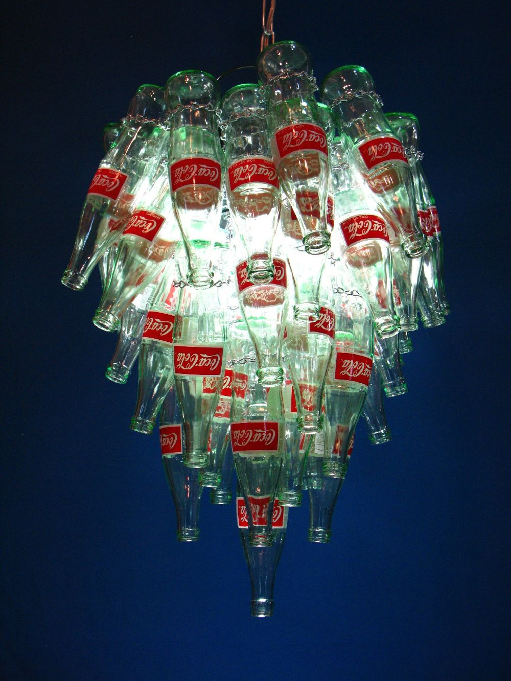 Vintage coke bottle chandelier created using 54 upcycled coke vintage coke bottle chandelier created using 54 upcycled coke bottles attached to a metal basket in a tapered cluster with a repurposed cake pan for the aloadofball Gallery
